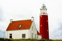 Leuchtturm mit Haus Stockfoto
