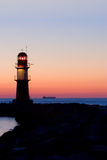 Leuchtturm nach Sonnenuntergang Stockfoto