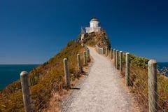 Leuchtturm am Nuggetpunkt, Catlins-Bereich, Neuseeland stockfotografie