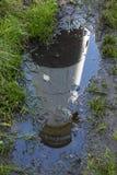Leuchtturm-Pfütze-Reflexion Lizenzfreies Stockbild