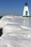 Leuchtturm-Pier und Eis Lizenzfreies Stockfoto
