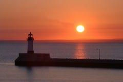 Leuchtturm am Sonnenuntergang Stockbilder