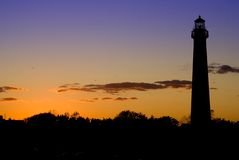 Leuchtturm am Sonnenuntergang Stockfotos