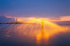 Leuchtturm-Sonnenuntergang Stockfoto