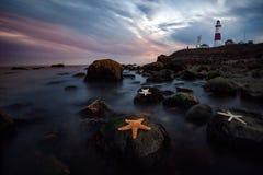 Leuchtturm-Sonnenuntergang Lizenzfreie Stockfotos