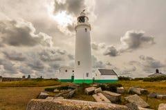 Leuchtturm u. Wolken Stockfotografie