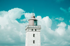 Leuchtturm und ein bewölkter Himmel Lizenzfreies Stockfoto