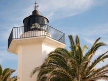 Leuchtturm und Palme Stockfotografie