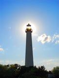 Leuchtturm und Sonne stockbild
