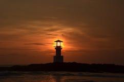 Leuchtturm und Sonnenuntergang Stockfotos