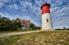 Leuchtturm und Wolken Stockfotografie