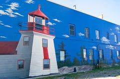 Leuchtturm-Wandbild auf Wand Stockfotografie