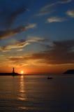 Leuchtturmsonnenuntergang Lizenzfreie Stockbilder