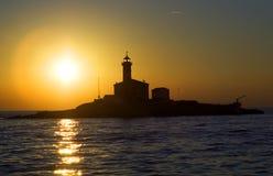 Leuchtturmsonnenuntergang Lizenzfreie Stockfotografie