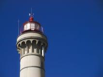 Leuchtturmturm mit blauem Himmel als Hintergrund Lizenzfreies Stockbild