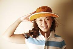 Leuk Aziatisch meisje met een begroeting stock fotografie