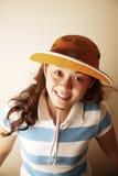 Leuk Aziatisch meisje met een hoed royalty-vrije stock afbeelding