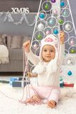 Leuk babymeisje bij Kerstmis Royalty-vrije Stock Foto