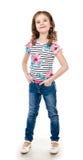 Leuk glimlachend geïsoleerd meisje in jeans Royalty-vrije Stock Foto's
