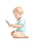 Leuk kind dat op een celtelefoon spreekt royalty-vrije stock afbeelding