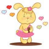 Leuk konijntje met chocolade en harten. Stock Afbeeldingen