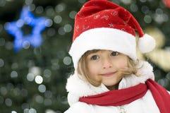 Leuk meisje bij Kerstmis Stock Afbeeldingen