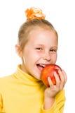 Leuk meisje die een appel bijten Royalty-vrije Stock Afbeelding