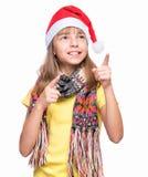 Leuk meisje die Santa Claus-hoed dragen stock afbeelding