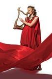 Leuk meisje in een rode uniformjas royalty-vrije stock afbeelding