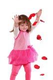 Leuk meisje in een roze kleding stock fotografie