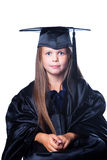Leuk meisje in graduatiekleding op geïsoleerdr wit Stock Foto