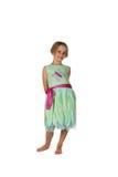 Leuk meisje in groene en roze de lentekleding Stock Afbeelding