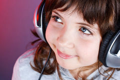 Leuk meisje met hoofdtelefoon Stock Foto