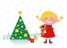 Leuk meisje met Kerstmisboom en giften Stock Foto