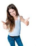Leuk meisje met omhoog duimen Royalty-vrije Stock Afbeelding