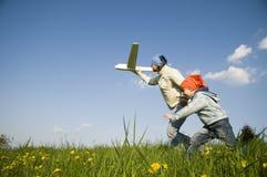 Leuk meisje met vliegtuig Stock Afbeelding