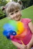 Leuk meisje met weinig windmolen Royalty-vrije Stock Foto