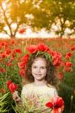 Leuk meisje op het papavergebied Royalty-vrije Stock Foto's