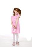 Leuk meisje in roze kleding Stock Afbeelding