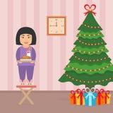 Leuk mooi Aziatisch meisjeskind die zich op een stoel dichtbij de Kerstboom bevinden Zaal binnenland in vector vlakke stijl Stock Foto