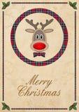 Leuk rendier in cirkel met rood plaidpatroon, op oude document achtergrond en test vrolijke Kerstmis, het ontwerp van de Kerstmis Royalty-vrije Stock Fotografie