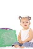 Leuk weinig baby met bord Stock Fotografie