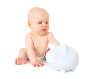 Leuk weinig baby met spaarvarken Royalty-vrije Stock Fotografie
