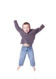 Het leuke jongen springen Stock Foto's