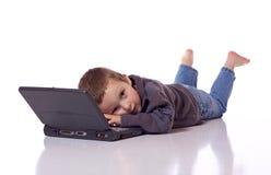 Leuke jongen met laptop Stock Fotografie