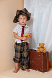 Leuk weinig jongen met de bloem. Royalty-vrije Stock Foto's