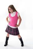 Leuk weinig schoolmeisje in roze stock afbeelding