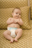 Leuke baby die luier draagt Royalty-vrije Stock Foto