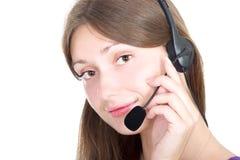 Leuke brunette met een hoofdtelefoon Stock Foto's