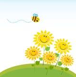 Leuke gele honingsbij met groep bloemen